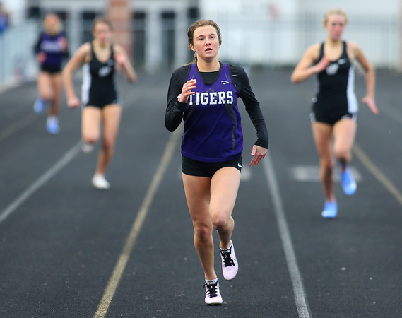 4-2-19<br /> Northwestern-Western track and field<br /> NW's Kailyn Devault in the 400 m dash.<br /> Kelly Lafferty Gerber | Kokomo Tribune