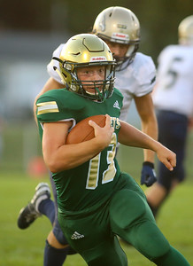 8-23-19 Eastern vs Oak Hill football Eastern's Zane Downing runs the ball. Kelly Lafferty Gerber | Kokomo Tribune