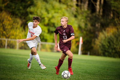Varsity soccer between Belmont HS (white) and Derryfield (maroon) held on October 1, 2019 at the The Derryfield School in Manchester, NH.