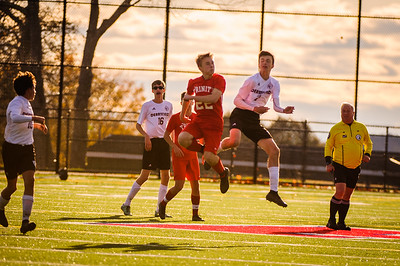Varsity soccer between Trinity HS (red) and Derryfield (white) held on October 18, 2019 at the Derryfield Park in Manchester, NH.
