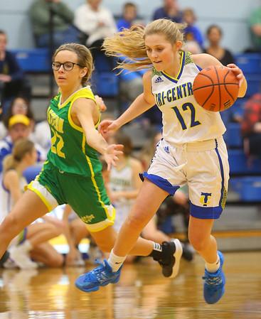 12-13-19<br /> Tri Central vs Eastern girls basketball<br /> TC's Kenadie Fernung drives the ball down the court.<br /> Kelly Lafferty Gerber   Kokomo Tribune