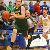 12-13-19<br /> Tri Central vs Eastern boys basketball<br /> Eastern's Austin Roberts dribbles down the court.<br /> Kelly Lafferty Gerber | Kokomo Tribune