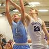 12-20-19<br /> Northwestern vs Maconaquah boys basketball<br /> Mac's Brayden Betzner and Mac's Braydyn Bishop go for a rebound.<br /> Kelly Lafferty Gerber | Kokomo Tribune