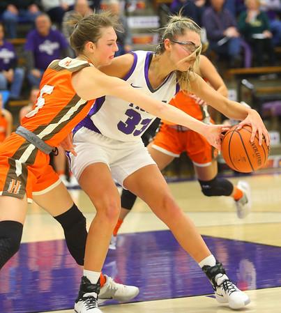 12-10-19<br /> Northwestern vs Hamilton Heights girls basketball<br /> NW's Madison Layden keeps the ball out of HH's Bayleigh Runner's grasp.<br /> Kelly Lafferty Gerber | Kokomo Tribune