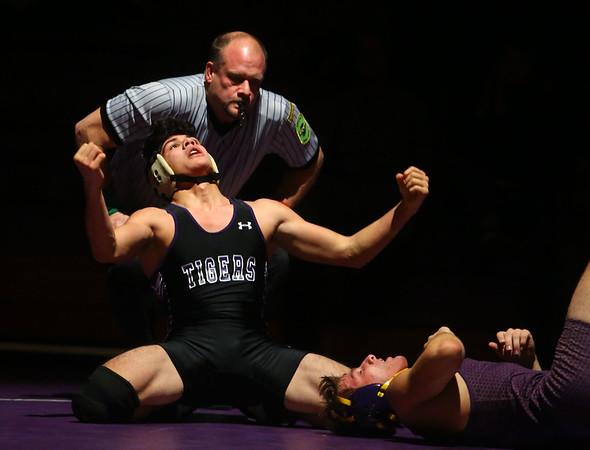12-19-19<br /> Northwestern vs Marion wrestling<br /> NW's Marcos Castorena defeats Marion's Garrett Scher in the 152.<br /> Kelly Lafferty Gerber | Kokomo Tribune