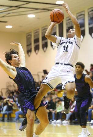 12-6-19<br /> Western vs Northwestern boys basketball<br /> Western's Nathaniel Liddell puts up a shot after getting fouled by NW's Ethan Kinney.<br /> Kelly Lafferty Gerber | Kokomo Tribune
