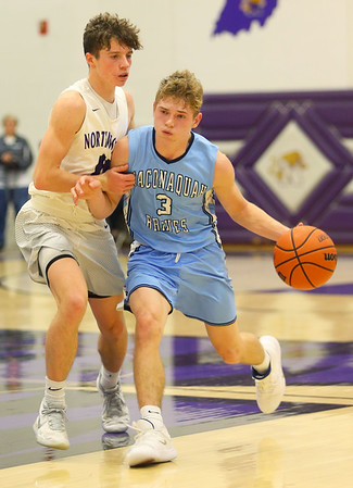 12-20-19<br /> Northwestern vs Maconaquah boys basketball<br /> Mac's Nolan Kelly takes the ball down the court.<br /> Kelly Lafferty Gerber | Kokomo Tribune