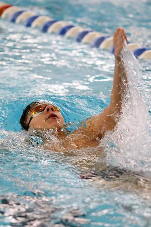 Kokomo's Alex Chandler swimming the100 backstroke during the swim meet between Kokomo HS and Northwestern HS on Monday December 16, 2019. Tim Bath   Kokomo Tribune
