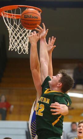 12-13-19<br /> Tri Central vs Eastern boys basketball<br /> Eastern's Ethan Wilcox goes for a rebound.<br /> Kelly Lafferty Gerber | Kokomo Tribune