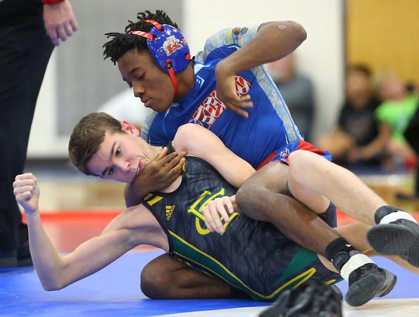 12-4-19<br /> Kokomo vs Eastern wrestling<br /> Kokomo's Harvey Barr defeats Eastern's Caleb Melton in the 106.<br /> Kelly Lafferty Gerber | Kokomo Tribune
