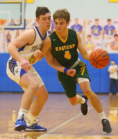 12-13-19<br /> Tri Central vs Eastern boys basketball<br /> Eastern's Matt Arcari takes the ball down the court.<br /> Kelly Lafferty Gerber | Kokomo Tribune
