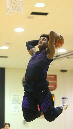 12-6-19<br /> Western vs Northwestern boys basketball<br /> NW's Tayson Parker makes a dunk.<br /> Kelly Lafferty Gerber | Kokomo Tribune