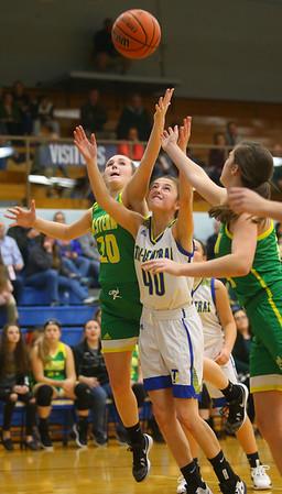 12-13-19<br /> Tri Central vs Eastern girls basketball<br /> Eastern's Kaylee Weeks and TC's Meghan Grubb go after a rebound.<br /> Kelly Lafferty Gerber | Kokomo Tribune