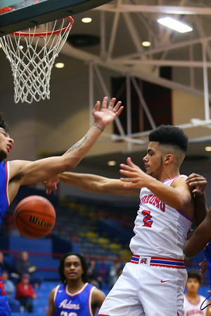 Ta'Shy Steward being stopped in the 3rd quarter during Saturday afternoon action between the Kokomo Wildcats and South Bend Adams Eagles on December 28, 2019. Tim Bath | Kokomo Tribune