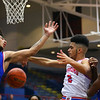 Ta'Shy Steward being stopped in the 3rd quarter during Saturday afternoon action between the Kokomo Wildcats and South Bend Adams Eagles on December 28, 2019.<br /> Tim Bath | Kokomo Tribune