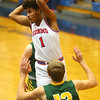 12-27-19<br /> Kokomo vs Eastern boys basketball in the Phil Cox Memorial Holiday Tournament<br /> Kokomo's Savion Barrett tosses a pass.<br /> Kelly Lafferty Gerber | Kokomo Tribune