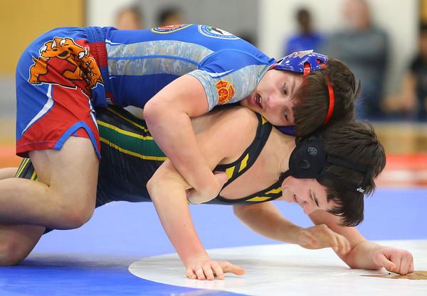 12-4-19<br /> Kokomo vs Eastern wrestling<br /> Kokomo's Kacey Coak defeats Eastern's Eli Ferguson in the 113.<br /> Kelly Lafferty Gerber | Kokomo Tribune