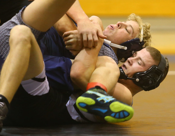 12-17-19<br /> Western vs LCC wrestling<br /> Western's Hunter Cottingham defeats LCC's Andrew Kline in the 138.<br /> Kelly Lafferty Gerber | Kokomo Tribune