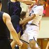12-6-19<br /> Western vs Northwestern boys basketball<br /> NW's Ethan Kinney and Western's Nathaniel Liddell go after a rebound.<br /> Kelly Lafferty Gerber | Kokomo Tribune