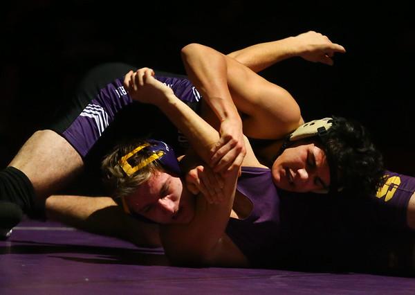 12-19-19<br /> Northwestern vs Marion wrestling<br /> NW's Marcos Castorena defeats Marion's Garrett Scher in the 152.<br /> Kelly Lafferty Gerber   Kokomo Tribune