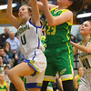 12-13-19<br /> Tri Central vs Eastern girls basketball<br /> TC's Olivia Johnson and Eastern's Kara Otto go after a rebound.<br /> Kelly Lafferty Gerber | Kokomo Tribune