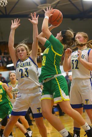12-13-19<br /> Tri Central vs Eastern girls basketball<br /> Eastern's McKenzie Cooper shoots.<br /> Kelly Lafferty Gerber | Kokomo Tribune