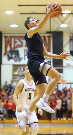 12-6-19<br /> Western vs Northwestern boys basketball<br /> NW's Nathan Bennett puts up a shot.<br /> Kelly Lafferty Gerber | Kokomo Tribune