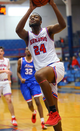 R.J. Oglesby for 2 in the 3rd quarter during Saturday afternoon action between the Kokomo Wildcats and South Bend Adams Eagles on December 28, 2019.<br /> Tim Bath | Kokomo Tribune