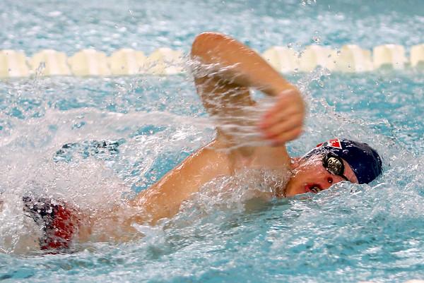 Kokomo's Logan Pitner swimming the 200 free relay during the swim meet between Kokomo HS and Northwestern HS on Monday December 16, 2019. <br /> Tim Bath | Kokomo Tribune