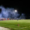 Colby Price kicks a field goal as the smoke from the canon lays across the field