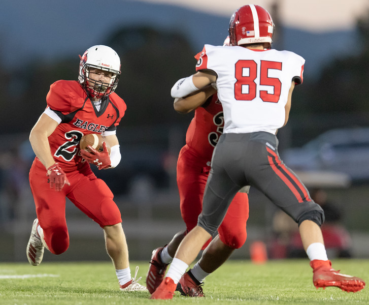 Colton Dean rushes with the ball as Jamarcus Davis preovides the block