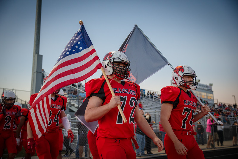 Ethan Mitchell (72) and Joseph Carrickhoff (75) leads the Eagles out on to the field