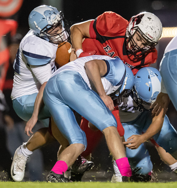 Wyatt Hensley (50) strips the ball from Jaden Rouse as he gets caught up between John Higgs (7) and Trey Knight III (5)