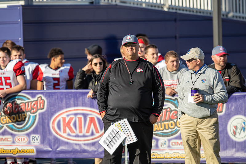 Coach Coleman waits patiently for the HHS and Rockbridge Game to complete so his Ealges can take the field