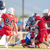 Ethan Barnhart (24) fights to get a little extra yardage against Logan Frye (4) and Colton Dean (24)