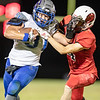 Benjamin Conahan battles with Logan Frye as he marches up field