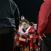 Matthew Fries looks up to Coach Coleman during the post game huddle
