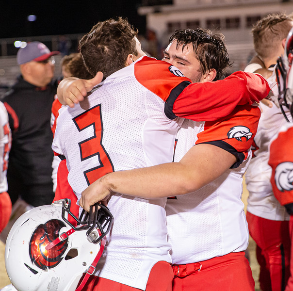 Lane Comer and Mark Carter console each other after the Eagles lost in the Region B title game.