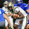 A Spotswood defender grabs on to Malachi Fields