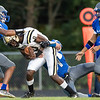 Rob Smith and Benjamin Conahan work togeather to bring down Monticello's Malachi Fields