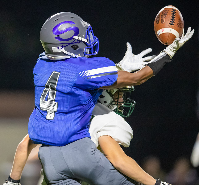 Quentin Hayes pulls down a pass from Ryan High.