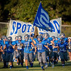 Benjamin Conahan carries the Spotswood Flag out onto the field