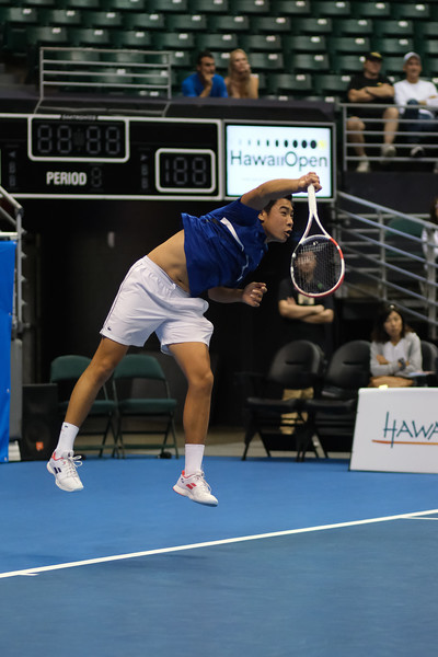 Brandon Nakashima finishes his serve against Sam Querrey in the finals of the men's draw of the 2019 Hawaii Open at the Stan Sheriff Center on December 28, 2019 in Honolulu, Hawaii.