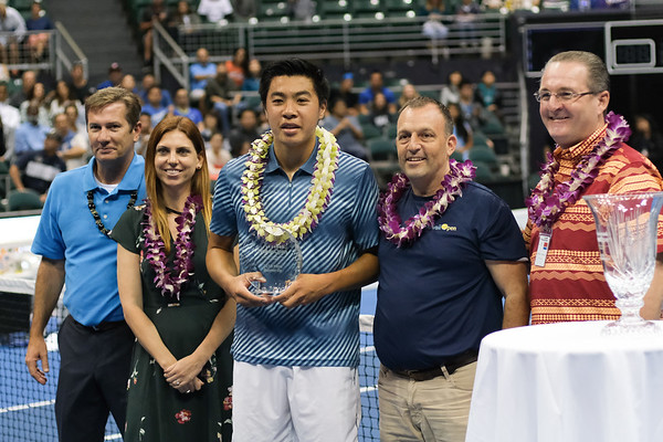 Brandon Nakashima displays his runner-up trophy at the 2019 Hawaii Open at the Stan Sheriff Center on December 28, 2019 in Honolulu, Hawaii.