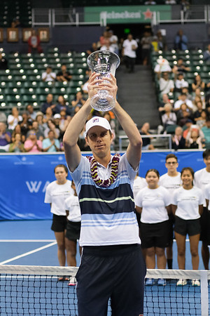 Sam Querrey holds his men's championship trophy after defeating Brandon Nakashima at the 2019 Hawaii Open at the Stan Sheriff Center on December 28, 2019 in Honolulu, Hawaii.