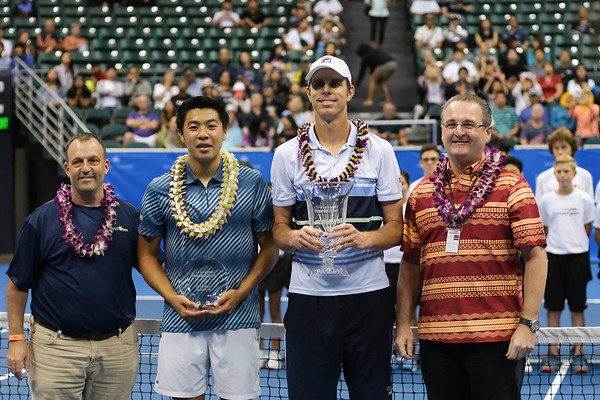 Men's runner up Brandon Nakashima (left) and champion Sam Querrey pose with their awards at the 2019 Hawaii Open at the Stan Sheriff Center on December 28, 2019 in Honolulu, Hawaii.