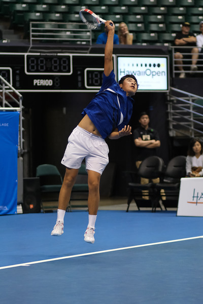 Brandon Nakashima serves against Sam Querrey in the finals of the men's draw of the 2019 Hawaii Open at the Stan Sheriff Center on December 28, 2019 in Honolulu, Hawaii.