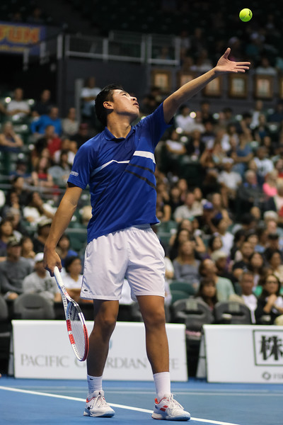 Brandon Nakashima tosses his ball before serving against Sam Querrey in the finals of the men's draw of the 2019 Hawaii Open at the Stan Sheriff Center on December 28, 2019 in Honolulu, Hawaii.