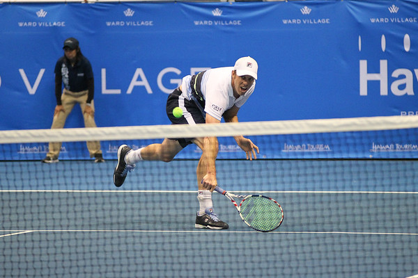 Sam Querrey stretches for a backhand against Brandon Nakashima in the men's finals of the 2019 Hawaii Open at the Stan Sheriff Center on December 28, 2019 in Honolulu, Hawaii.