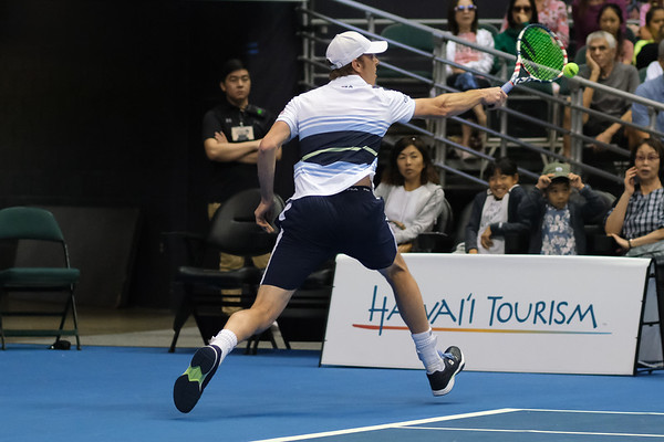 Sam Querrey reaches for a backhand against Brandon Nakashima in the men's finals of the 2019 Hawaii Open at the Stan Sheriff Center on December 28, 2019 in Honolulu, Hawaii.